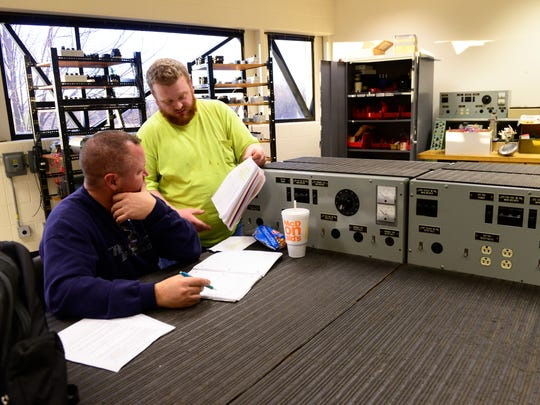 Students Pierson Lorandeau, left, and Corey Arnold  study for a motor controls final lab at Terra State Community College.