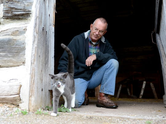 Dan Katers, the farmer and gardener at Heritage Hill State Historical Park, is often greeted each morning by Alphonse, who accompanies him on his rounds to feed the other animals at the Belgian Farm.