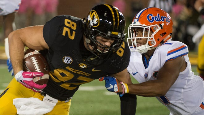 Missouri tight end Clayton Echard, left, is tackled during a game against Florida on Oct. 10, 2015, at Faurot Field.