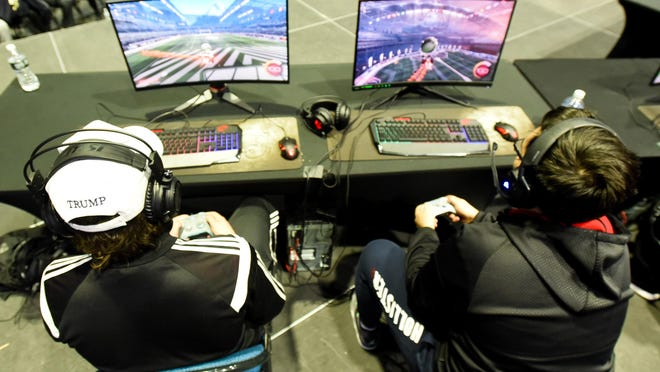 """College students play Rocket League while participating in a """"Battle of the Colleges"""" esports tournament in New York this year."""