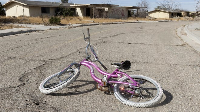 A bicycle sits in front of abandoned housing at George Air Force Base in 2018.
