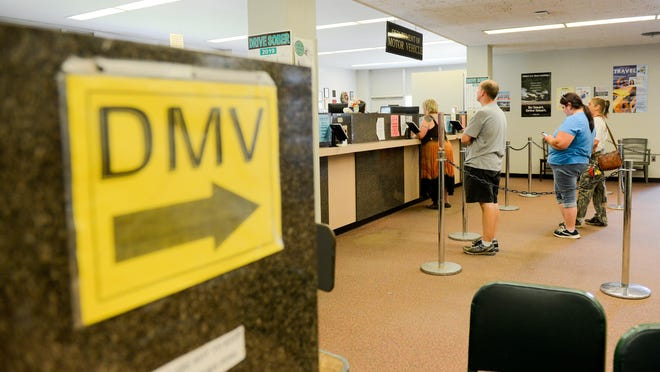 In this file photo from 2019, guests wait in line at the Herkimer County Department of Motor Vehicles in Herkimer. While the DMV is working to reopen, most transactions will still take place via mail.