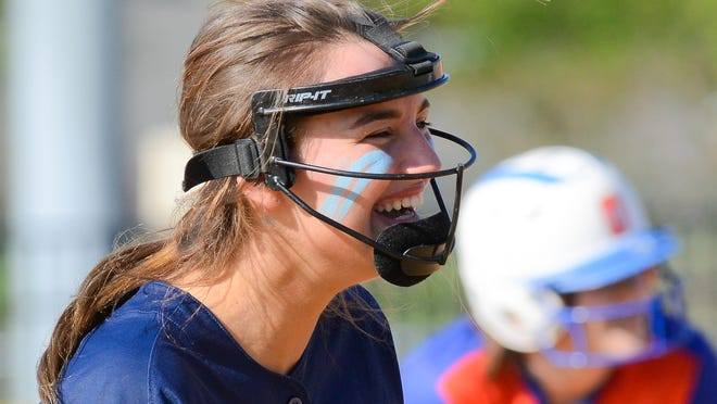 CVA player Sianna Kenyon (9) laughs with a teammate after a play during the softball game against Oneida on Thursday, May 16, 2019 in Oneida.