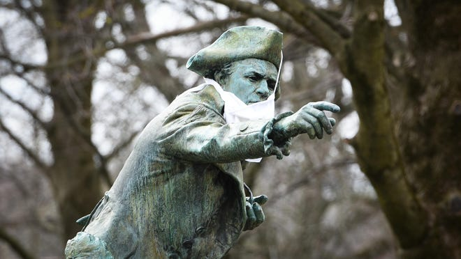 A makeshift mask is displayed on the General Herkimer monument in Herkimer's Myers Park recently.