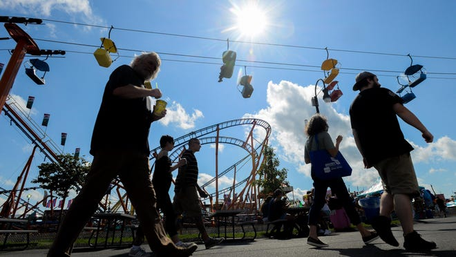 Fair-goers in 2019 take in a sunny during opening day at the Great New York State Fair in Geddes. The pandemic's impact on the fairgrounds extends beyond the cancellation of the state fair.