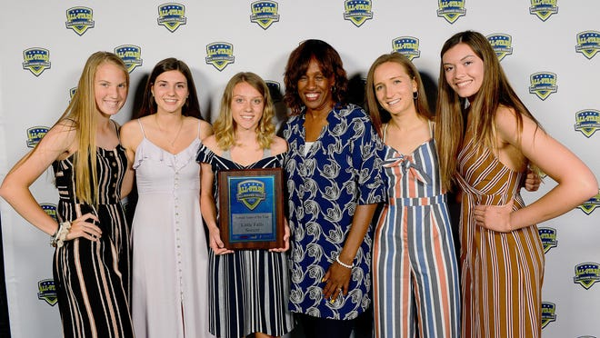 Left to right: Olivia Lindsay, Nicole Failing, and Gabby Sylstra of the Little Falls girls soccer team takes a photo with Olympian Jackie Joyner-Kersee and their teammates Geena Morotti and Olivia Langdon at the All-Mohawk Valley All-Stars banquet June 18, 2019 at Mohawk Valley Community College. Little Falls shared the 2019 All-Mohawk Valley Female Team of the Year award with Holland Patent's girls soccer team.
