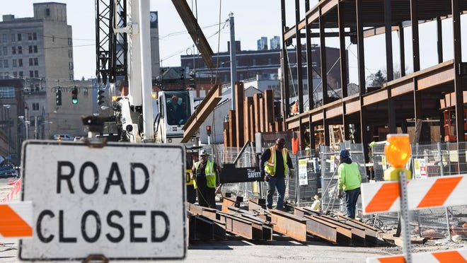 In this March 2020 file photo, crews work on the site of the Nexus Center in Utica. Construction has stopped at the site.