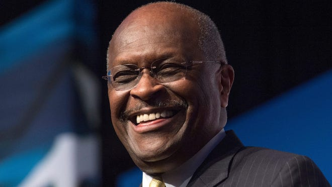 Herman Cain, CEO, The New Voice, speaks during Faith and Freedom Coalition's Road to Majority event in Washington on June 20, 2014. Former Republican presidential candidate Herman Cain died after a battle with COVID-19, according to posts on his Twitter account and on his website.MOLLY RILEY, AP