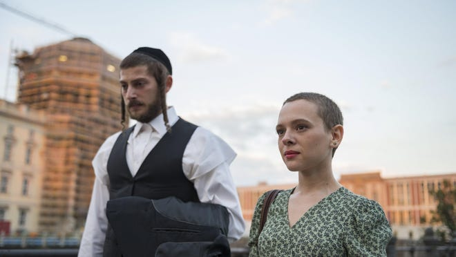 """Shira Haas, right, with Amit Rahav in a scene from the series """"Unorthodox"""""""