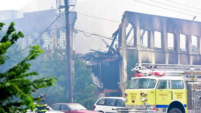 Several fire departments battle a large fire Thursday that broke out at the former CharlesTown Mall complex.