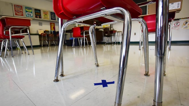 Blue masking tape marks socially-distanced areas where desks and chairs will be located in classrooms at Westmoreland Upper Elementary School this fall.