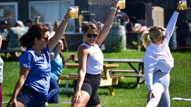 Guests participate in a beer yoga session hosted by In Bloom Yoga during a fundraiser on Saturday, September 5, 2020 at Woodland Farm Brewery. The fundraiser was for former bartender Mathew Fredericks, who died in a car accident on Aug. 4.