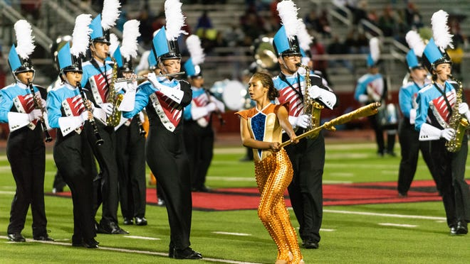 Monterey High School's band, The Swingin' Beat from 50th Street, performs during halftime of the Monterey and Lubbock-Cooper football game Sept. 21, 2018, at Pirate Stadium in Woodrow. The LISD board voted Thursday to allow students taking classes online, due to the COVID-19 pandemic, to participate in in-person extracurricular activities and elective courses, including band, sports, welding, cosmetology and others.