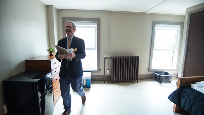 Spectrum Youth and Family Services Executive Director Mark Redmond tours the program's new residence facility at 177 Pearl St. Burlington in 2012. Redmond said the project cost $260,000 to renovate.