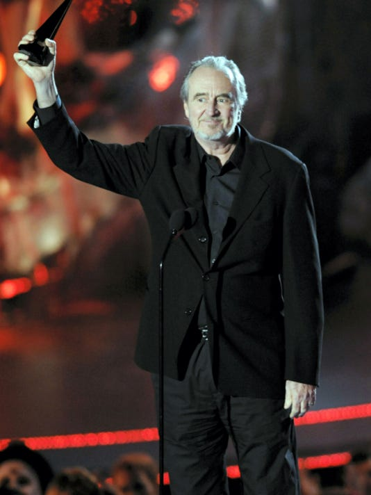 """File- This Oct. 18, 2008, file photo shows director Wes Craven accepting the Visionary Award at the Scream Awards in Los Angeles. Craven, whose """"Nightmare on Elm Street"""" and """"Scream"""" movies made him one of the most recognizable names in the horror film genre, has died. He was 76. Craven's family said in a statement that he died in his Los Angeles home Sunday, Aug. 30, 2015, after battling brain cancer. (AP Photo/Chris Pizzell, File)"""