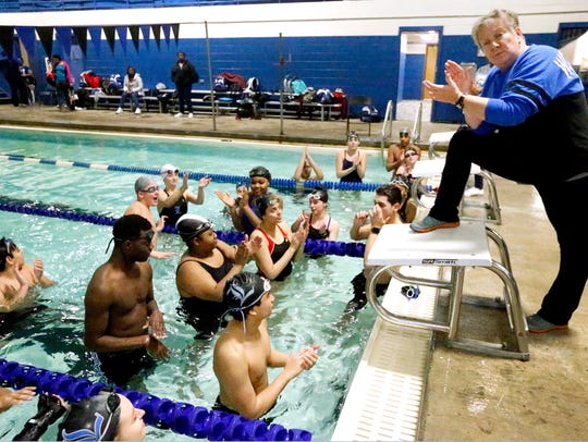Coach Amy Caulkins cheers on swimmers going to state