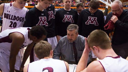 Madison boys basketball coach Michael Ricke talks to