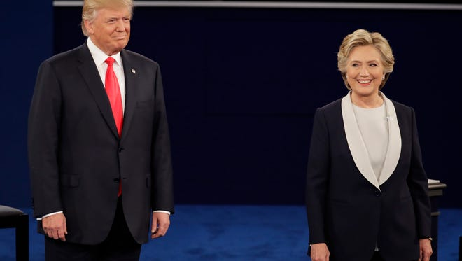 Republican presidential nominee Donald Trump stands next to Democratic presidential nominee Hillary Clinton during the second presidential debate at Washington University in St. Louis on Sunday.