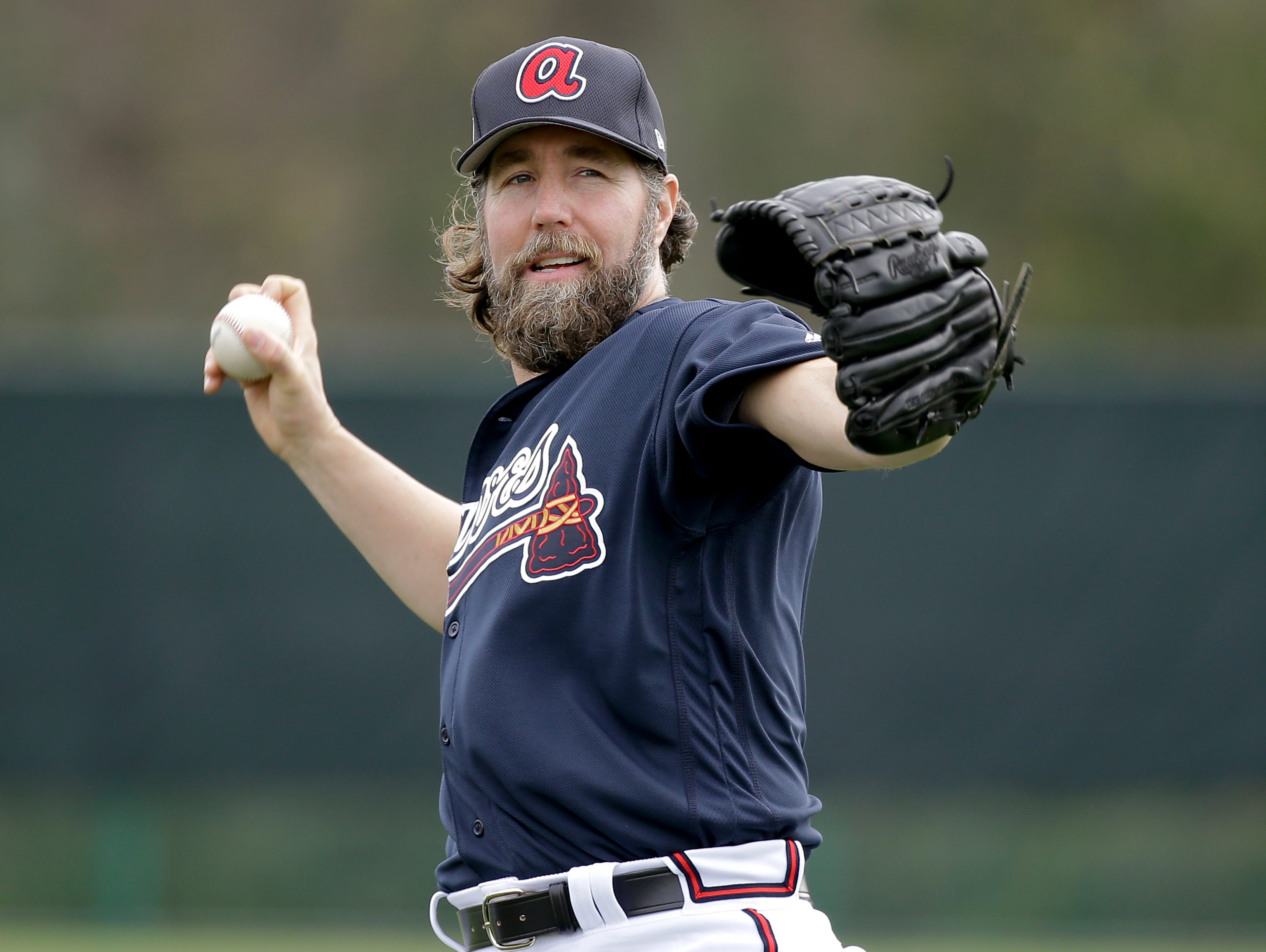 Atlanta Braves pitcher R.A. Dickey warms up at a spring training workout on Feb. 15, 2017.