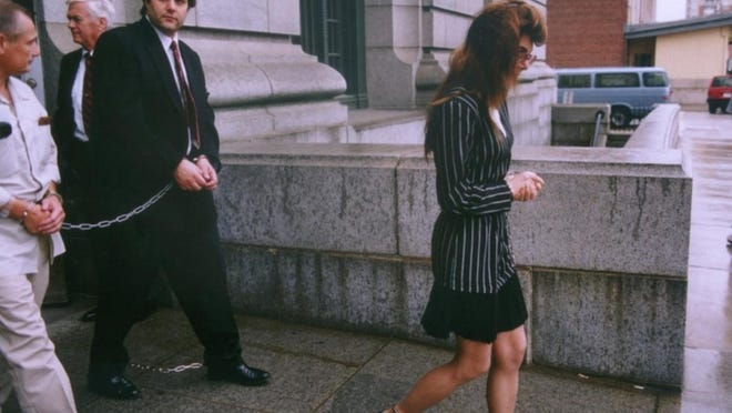 Stephen and Donna Saccoccia leave the federal courthouse in Providence in 1992.