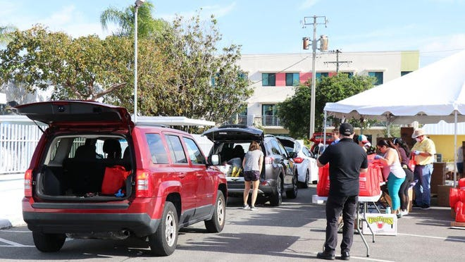 A food distribution event last week in Lake Worth Beach aided more than 420 families.