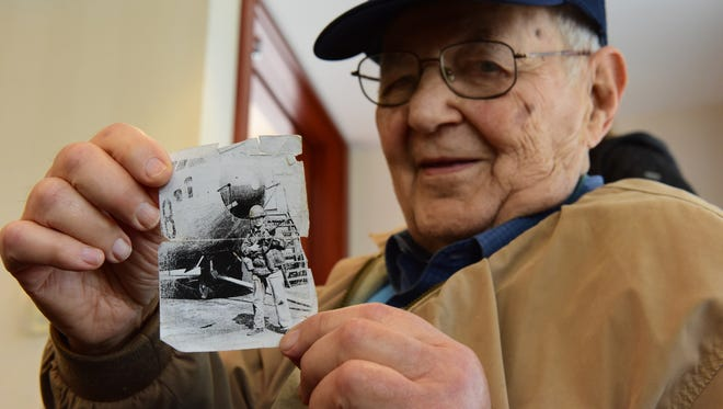 Jesse Rosenzweig holds a photo of himself while serving during the Korean War. Members of the Jewish War Veterans, of Fair Lawn, will march in the town's Memorial Day Parade.