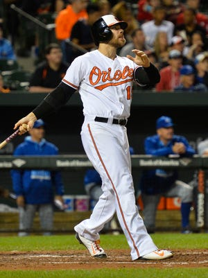 Chris Davis watches his MLB-leading 42nd home run leave the yard.