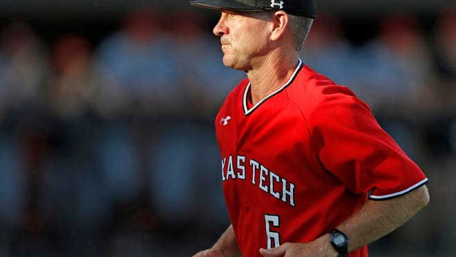Texas Tech coach Tim Tadlock runs back to the dugout during the team's NCAA college baseball tournament regional game against Louisville, Saturday, June 2, 2018, in Lubbock, Texas. (Brad Tollefson/Lubbock Avalanche-Journal via AP)