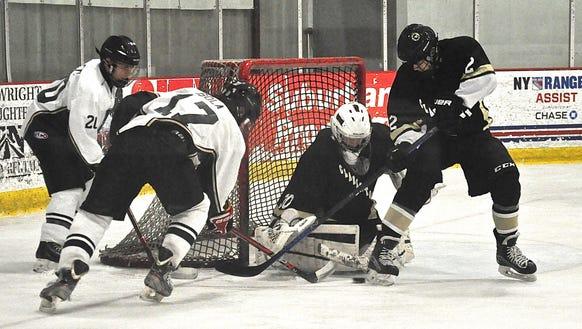 Clarkstown goalie Jason Inzeo stops a shot by Brewster-Yorktown's
