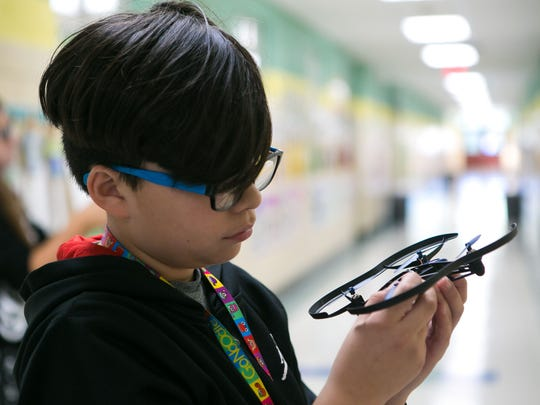 Brandon Marquez, 10, and his fifth grade classmates at Pleasantville Elementary, learn coding and engineering by using ground and aerial drones.