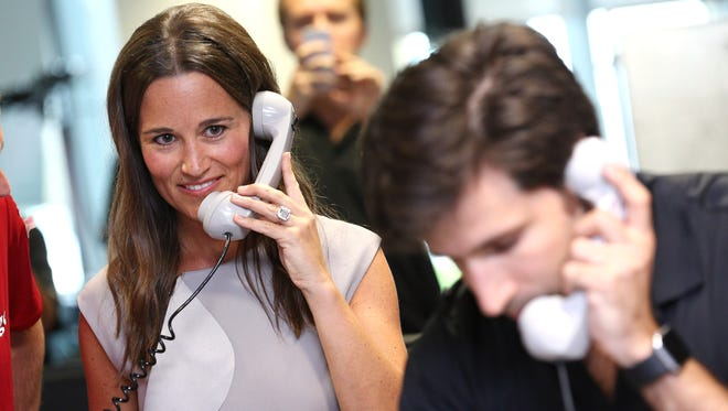 Pippa Middleton making a trade at BGC Annual Global Charity Day at Canary Wharf on Sept. 12, 2016 in London.