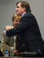 Ceil Levatino, now a former city councilor gets a hug