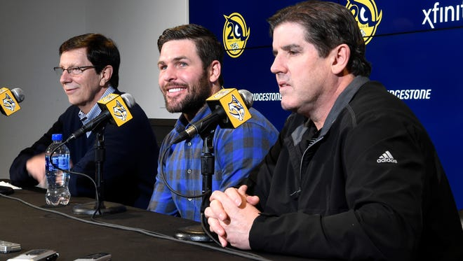 Mike Fisher announces his return to the Nashville Predators at a press conference with President of Hockey Operations/General Manager David Poile, left, and Head Coach Peter Laviolette at Bridgestone Arena Wednesday, Jan. 31, 2018 in Nashville, Tenn.