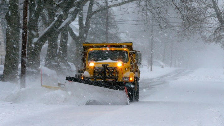 A snow plow clears North Scotch Plains Avenue in Westfield,