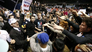 Supporters of Donald Trump, left, face off with protesters on the campus of the University of Illinois-Chicago on March 11, 2016, where a rally was cancelled due to security concerns.