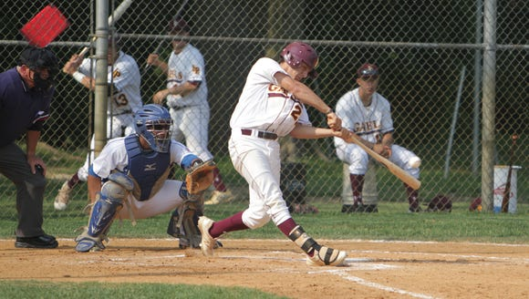 Iona Prep's Anthony Piccolino makes contact with the
