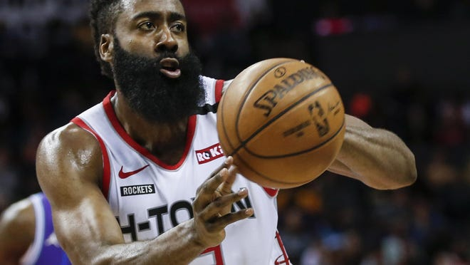 Houston Rockets guard James Harden passes against the Charlotte Hornets during the second half of an NBA game in Charlotte, N.C.