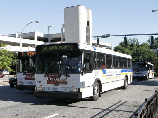 Westchester County Bee-Line buses drive past the White