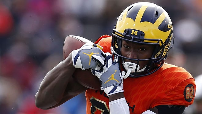 Amara Darboh of the North team catches the ball as Dwayne Thomas of the South team defends during the first half of the Reese's Senior Bowl Saturday in Mobile, Ala.