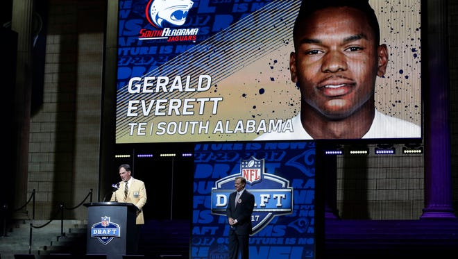 Former Los Angeles Rams star Jack Youngblood, left, announces South Alabama tight end Gerald Everett as the Rams' selection in the second round of the 2017 NFL Draft on Friday night in Philadelphia.