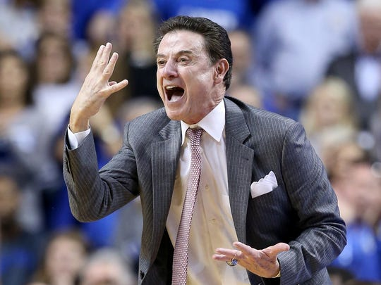 Rick Pitino, coach of the Louisville Cardinals, gives instruction to his team against the Kentucky Wildcats on Dec. 26, 2015, at Rupp Arena in Lexington, Ky.