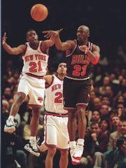 New York Knicks' Charlie Ward tries to intercept a pass to Chicago Bulls' Michael Jordan.