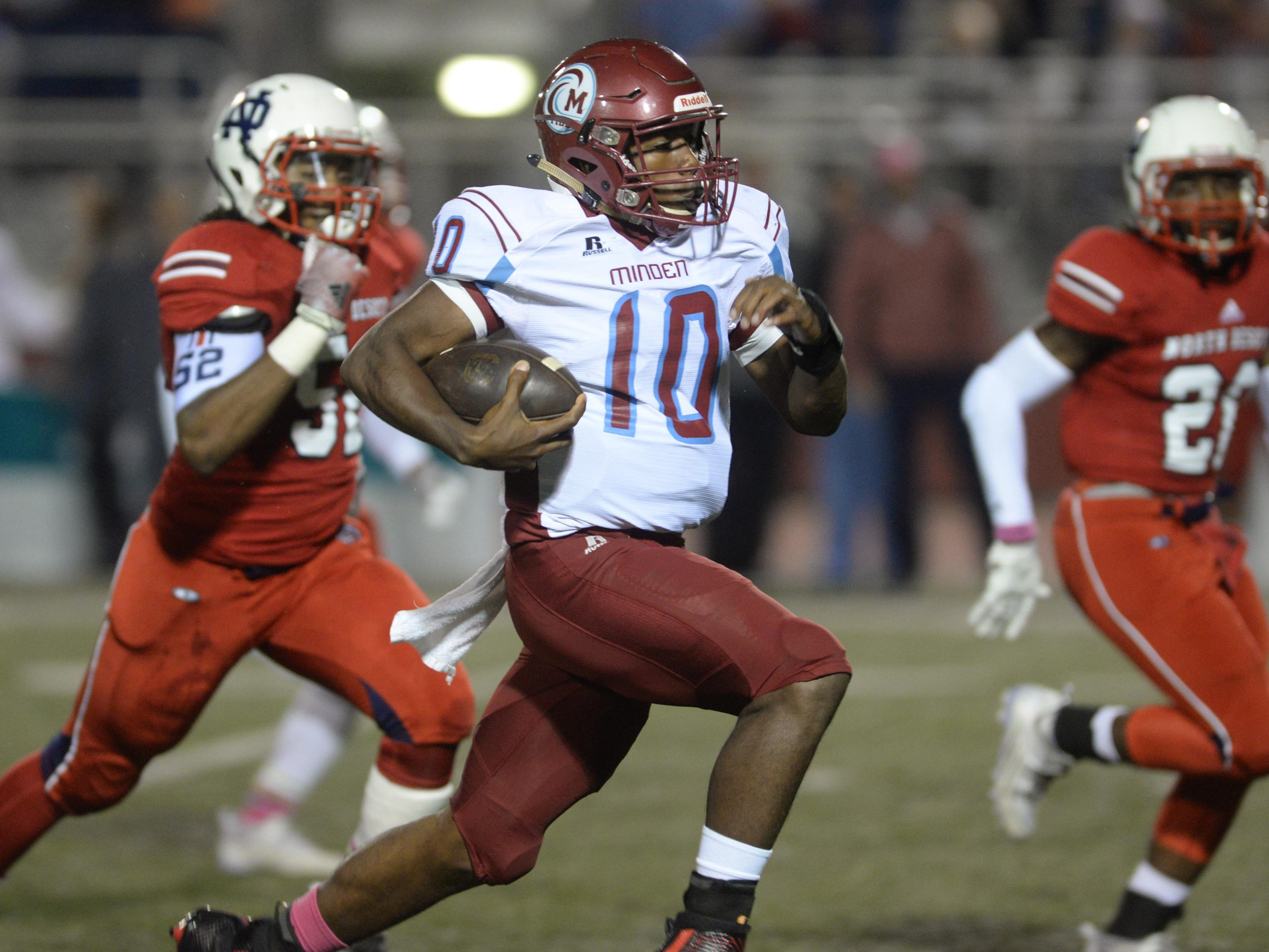 Minden quarterback Antonio Rivette sprints down the middle of the field for a touchdown as North DeSoto takes on Minden.