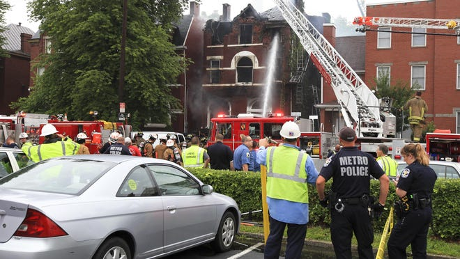 Firefighters battle a house fire on South Second Street. Two people died in the blaze and four injured. July 2, 2015