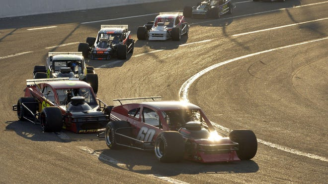 Cars race at Lake Erie Speedway during a Race of Champions Modifieds heat in 2016 in Greenfield Township. ROC racing action is taking place this weekend at Lake Erie Speedway.