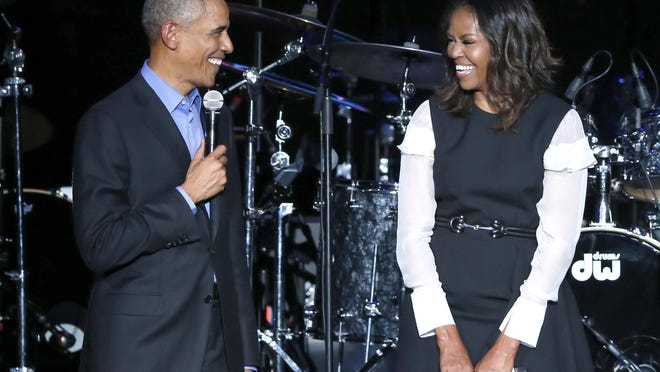 Former President Barack Obama, left, and former first lady Michelle Obama appear on stage during a community concert at the Obama Foundation Summit on Nov. 1, 2017, in Chicago.