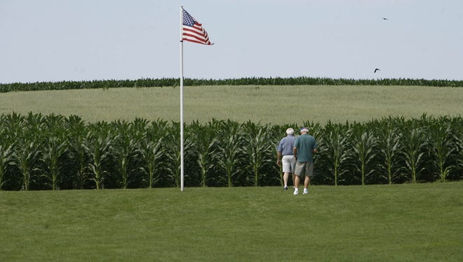 Visitors walk out into the corn at the Field of Dreams movie site northeast of Dyersville during the Register's Annual Great Bicycle Ride Across Iowa in 2007. Dyersville was the second to the last stop for riders.