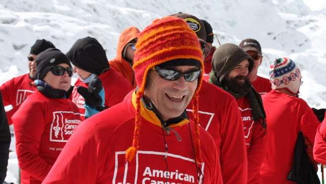 Dr. Richard Deming, leads the American Cancer Society's Relay For Life in Everest Base Camp in 2011. The event was the conclusion of a 9-day trek, during which 13 central Iowa cancer survivors journeyed to the base of the world's largest mountain.(Special to The Register)