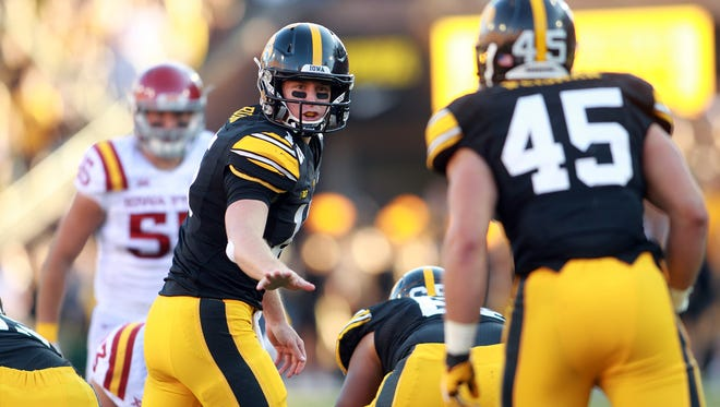Jake Rudock looks back at running back Mark Weisman during Iowa's 20-17 loss to Iowa State on Sept. 13.