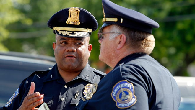 Chief of the Indianapolis Metropolitan Police Department Rick Hite, left, speaks with another officer following a press conference on the shooting of seven people in Broad Ripple on early Saturday.
